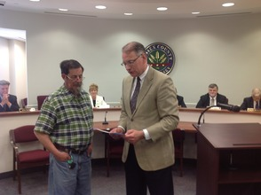 "Dennis Mudrick presents the proclamation to Hank Pomerantz for ""Relay for Life Days."""