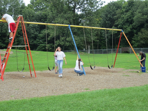 Scraping and sanding the large swing set- a group effort.