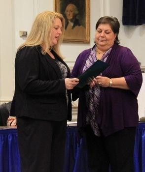 Brenda Beebe takes her oath with Linda Alvarez
