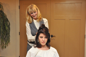 Maryse Denzer styles Hannah Paternoster's hair.