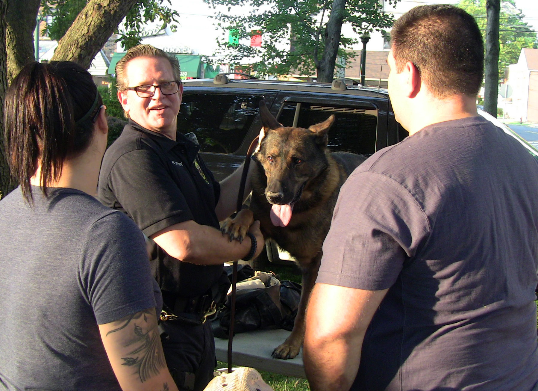 56f0cc205d7ec041e9ed_Brian_Cheney_and_K-9_unit.jpg