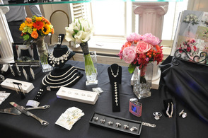Flowers with Sussex County Florist share a table with baubles from D'Andrea's Jewelers.