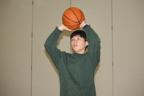 Justin Shoots Basketball