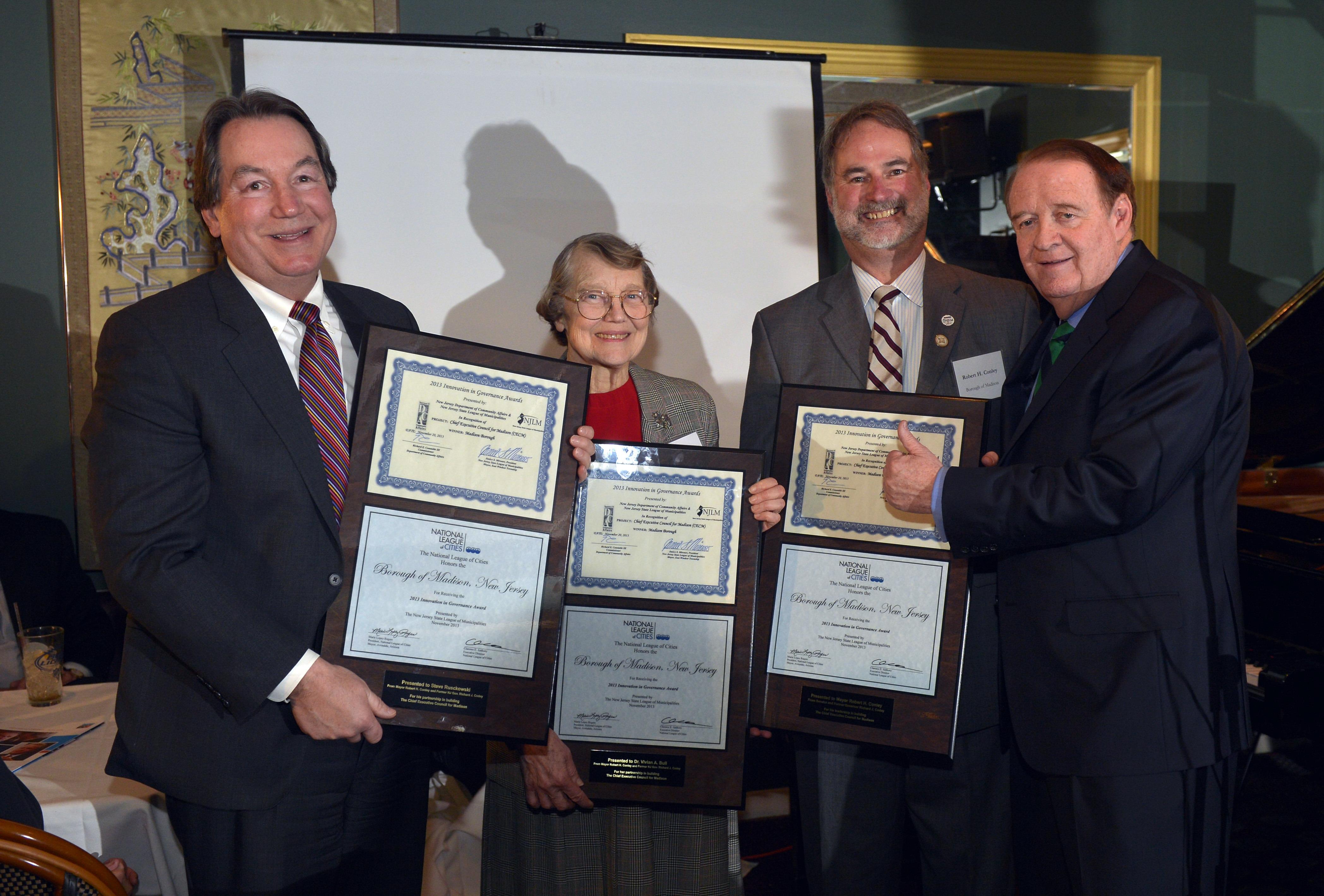 afab5d468b68ca9eecdd_CECM_Co-Chairs_Receiving_Award.jpg