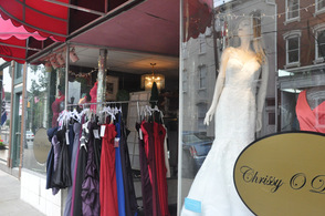 Gowns hang outside of Chrissy O Designs.