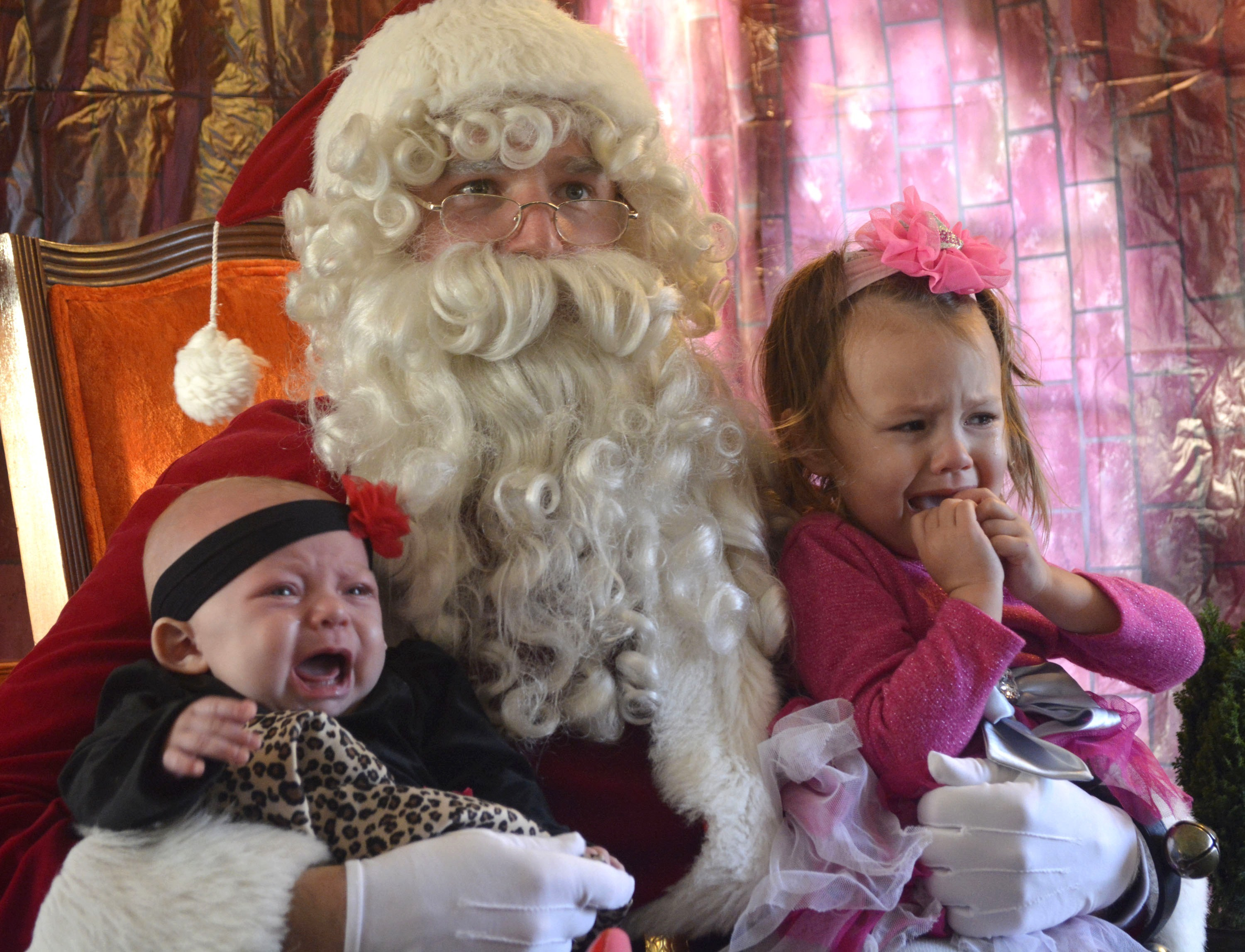 2c36fcffb502129ea3f9_Santa_and_babies_crying.jpg