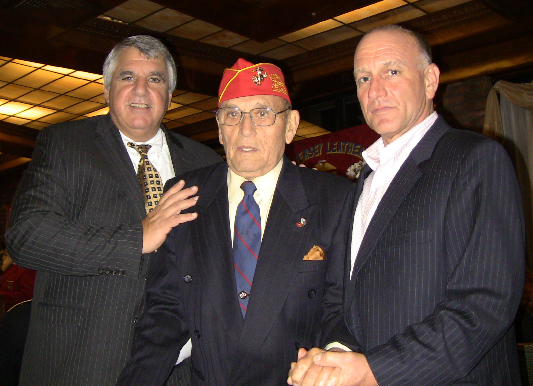 47b8909ce72656d01f16_Kevin_Glover-Mauro_Checchio-Jim_Checchio_at_Marines_Birthday_party.jpg