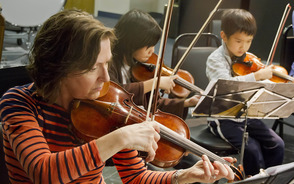 Carousel_image_801325f106b345a2507e_musicians_of_all_ages_play_side-by-side_in_njio