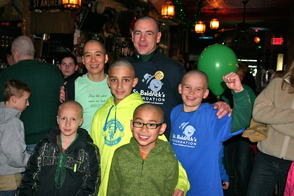 Shavees from 2013 St. Baldrick's event in Madison included (from left to right, front row) Eric Selquist, Keaton Tom, (middle row) Owen Eilender, Aidan Fassnacht, (back row) Karen Tom and Dennis Mullins Jr. of Poor Herbie's.