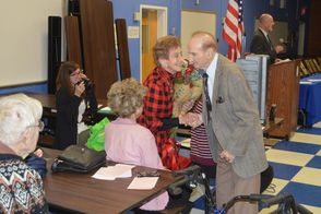 Ray Swidersky greets his wife Laura with flowers