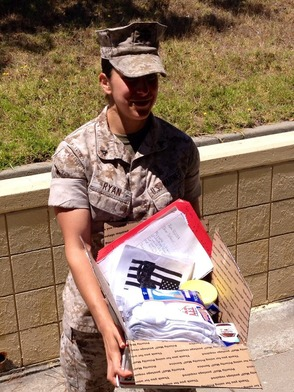 LCPL Julie Ryan of the U.S. Marine Corps. poses with her Operation Home Front care package.