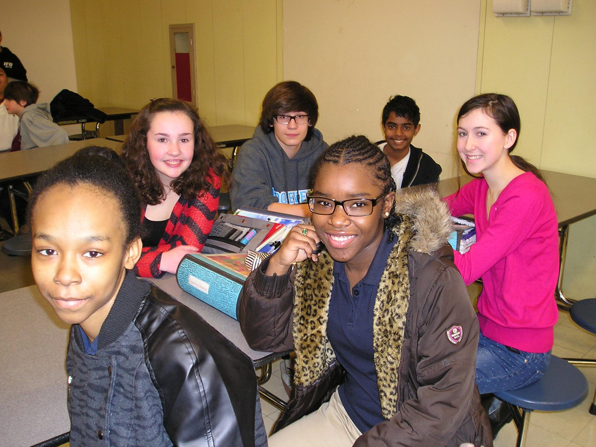 c64b983c3cc5d4d30975_Plainfield___Roosevelt_students_in_cafeteria_discussion.JPG