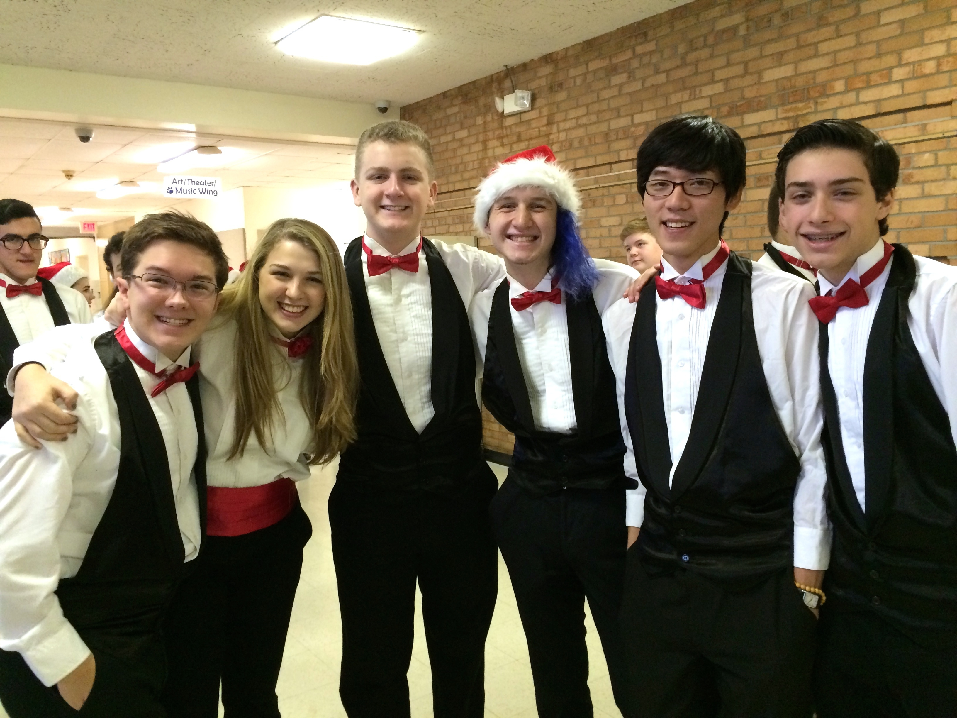 11729029ce5769f1d71d_92c8f6542a589dc70fd8_Members_of_the_CHS_Select_Choir_prepare_to_take_the_stage.jpg