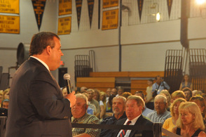 Attendees listen intently to the Governor as he speaks.
