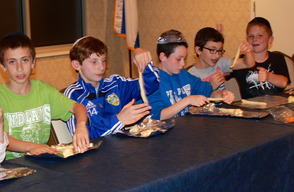 Sixth and seventh-grade students baked challah in the kitchen at Congregation Beth Israel on November 6.