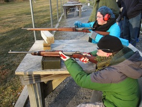 Stephen Rozek (Crew Secretary) & Grace Seltzer (Crew Treasurer) fire two of the rifles they learned about.