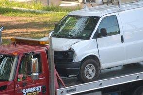 Damage to Front Panels of White Van