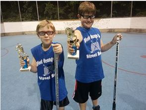 Brothers Pose with Trophies