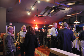 Chamber members socialize in the bar area of Down to the Bone Barbecue & Company, at their most recent Business After Hours.