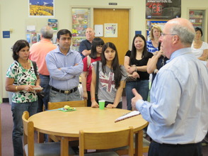 Dr. Miron welcomes new students and their parents to the district