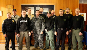 Back row (left to right): Officer Robert Kaiser, Detective Ed delaFuente, Officer Adam Norris, Sergeant Ron Guensch, Officer Michael Goldfarb Front Row (left to right): Officer Travis Jiroux, Detective John Mendelsohn, Detective Collin McMillan, Detective Andy DelRusso, Officer John Rebelo, Sergeant Jim Little