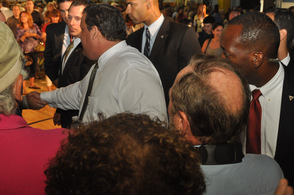 Governor Chris Christie shakes hands with attendees as he departs.