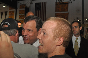 Governor Chris Christie speaks to an attendee as he leaves, as other smile while meeting the Governor.