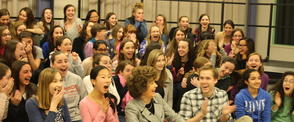 This photograph of the Advanced Choir was taken at the moment they learned they would be performing at the Super Bowl!