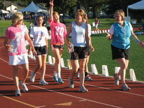 Participants in the 2012 Relay for Life of Madison/Florham Park circle the track to raise funds for the American Cancer Society.