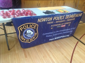 Newton Police banner, with D.A.R.E. items for the students.