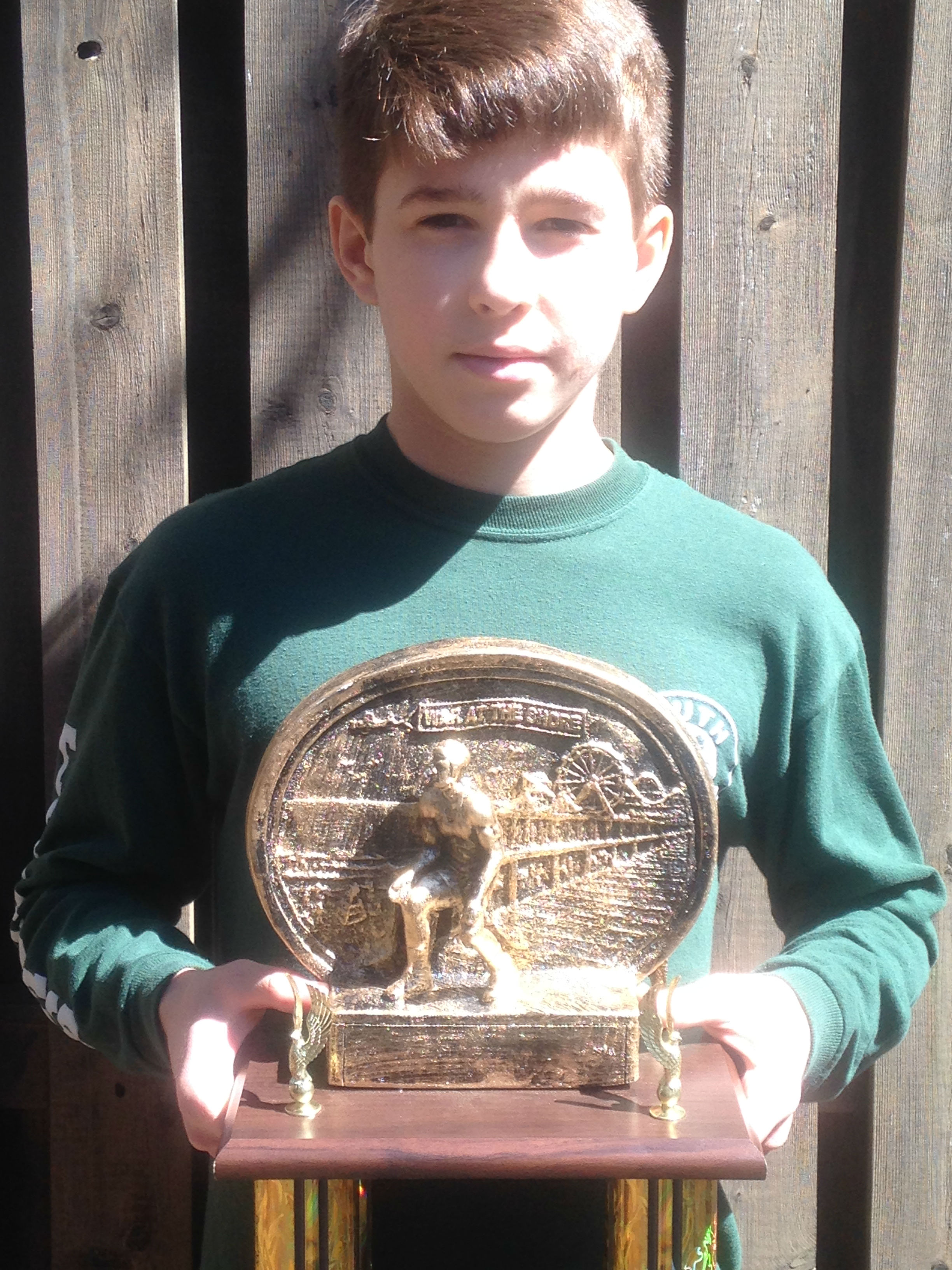 50421f593473964e5676_Anthony_White_Holding_1st_Place_War_at_the_Shore_Trophy_Picture.jpg