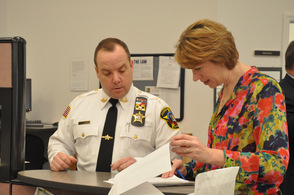 Sussex County Sheriff Michael Strada turning in his petition on March 27, and signs some documentation for Sussex County Deputy County Clerk Angela Rosa.