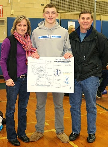 a72d99804fe7baa0c3ef_Brian_Lapham_and_parents_with_sign.JPG