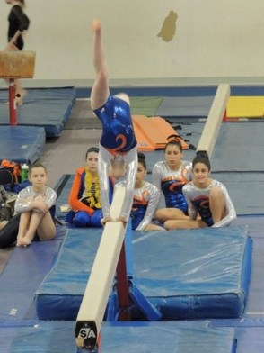 Amanda LiCausi in her Back Walkover on the Balance Beam.