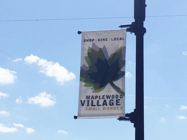 92bf4c070e8e1ecedbaf_maplewood_village_sign.jpg
