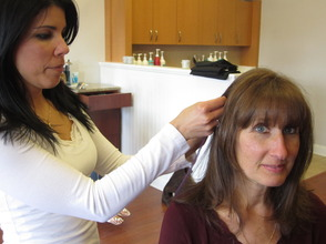 Cathy D's Hair Design owner Cathy Lagravenis (left) fashions a purple hair extension onto Relay for Life of Madison/Florham Park chairwoman, Barbara Bartolomeo, to promote the salon's fundraiser for the American Cancer Society.