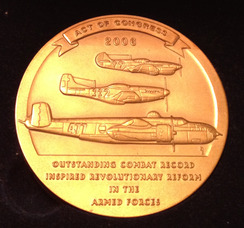 The back of the Congressional Gold Medal recognizes the 617th Bomber Squadron, 477th Composite Group, and the 332nd Fighter Group