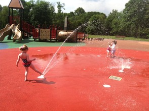 Kids playing in the sprinklers at Ponderosa Park
