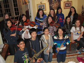 Members of the Junior Musical Club rehearsing for the Ensemble Concert to be performed April 2 at 7:30.