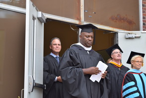 CBS Anchor Jim Axelrod and Principal James Earle leading the processional