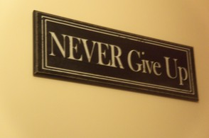 Never Give Up motivational sign