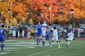 Millburns Evan Bograd and Montclair's Jake Seaman go for the ball in front of the Millers' goal.