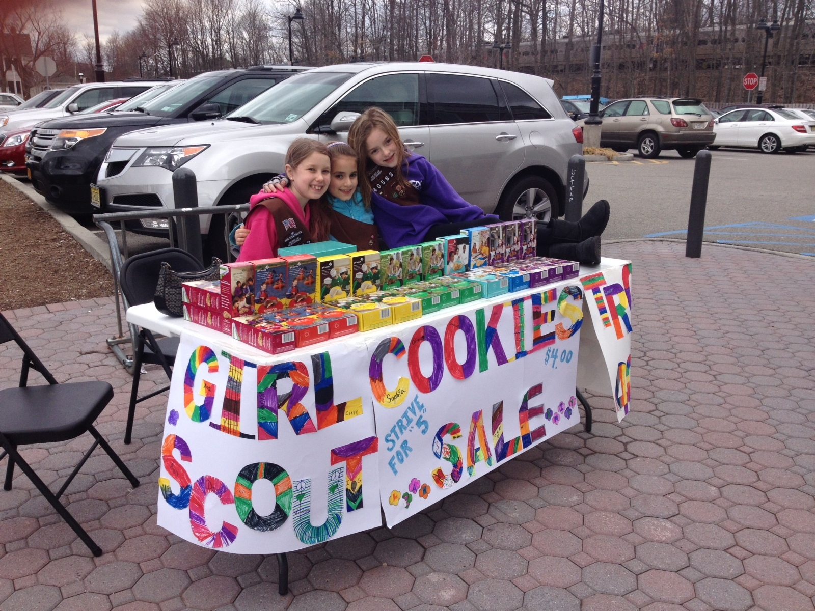 a2a25e909044aa0be844_Troop_40583_2014_Cookie_Sale_Booth.jpg