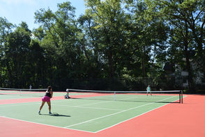 Eve Robinson and Anna Marie Bordonaro playing on the tennis courts