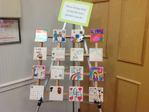 Tiles on display by student artists, portray things that help them to be the best that they can be.
