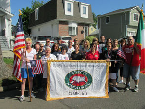 Clark Unico Poses for a Group Photo Before the Parade