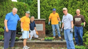 Kiwanis members plant flowers