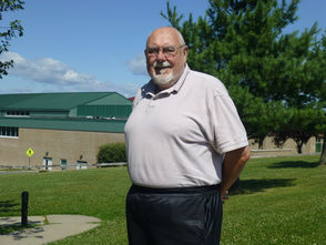 Michael O'Brien stands in front of Montville Township High School where he worked for over 40 years.