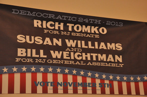 Sign promoting the Democratic Team of Tomko, Williams, and Weightman.