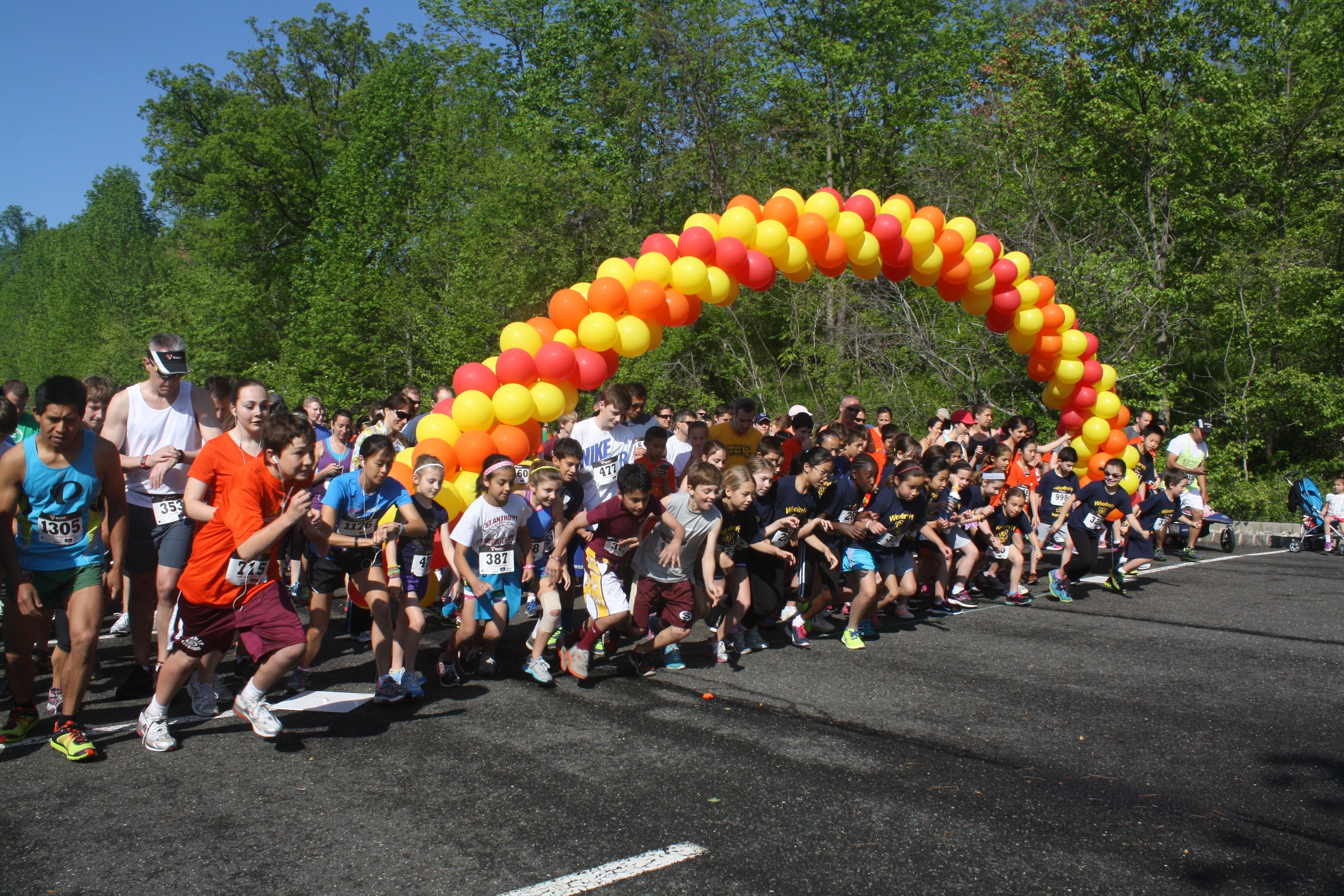 17580147b98e7af03649_MD5K_Runners_at_the_Start.JPG